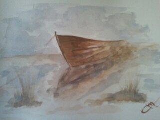Une barque dans la brume